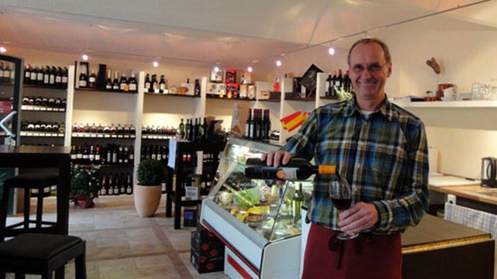Carlos verkauft Wein.